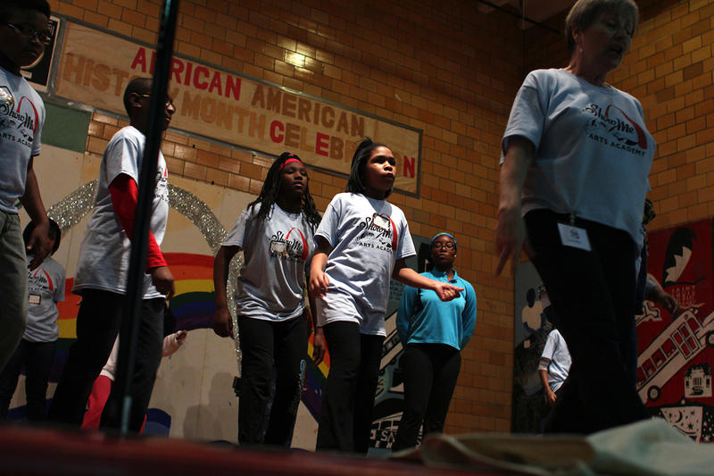 """Show Me Arts Academy kids rehearse a dance to Bruno Mars' """"Uptown Funk"""" during the program's launch last year"""