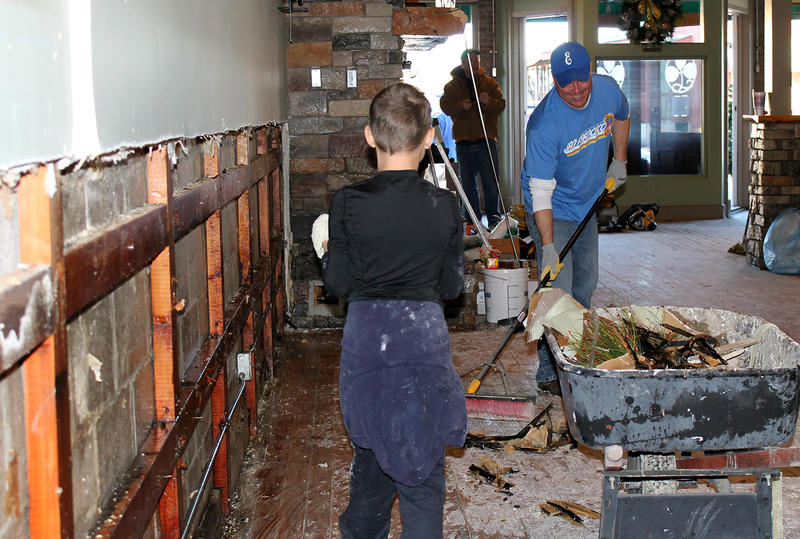Volunteers clean-up Odell's Irish Pub and Ale House in Eureka, Mo. on Sat. Jan. 2, 2016. Owner Jerry O'Dell says he hopes to reopen in time for St. Patrick's Day.