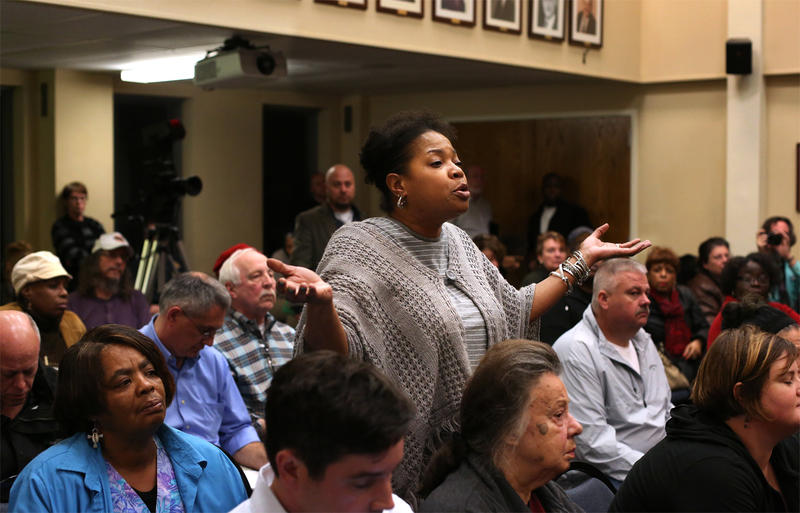 Ferguson resident Felicia Pulliam questions city officials during a city council meeting called to discuss the Department of Justice's proposed consent decree at Ferguson's city hall Tuesday evening.