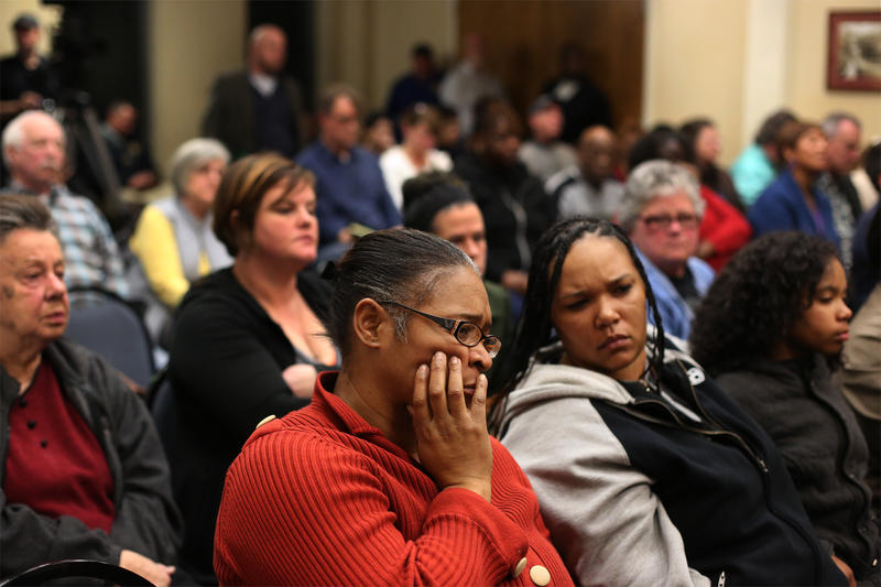 Ferguson residents Erica Brooks and Francesca Griffin listen to city council members discuss resident concerns on Feb. 2, 2016.