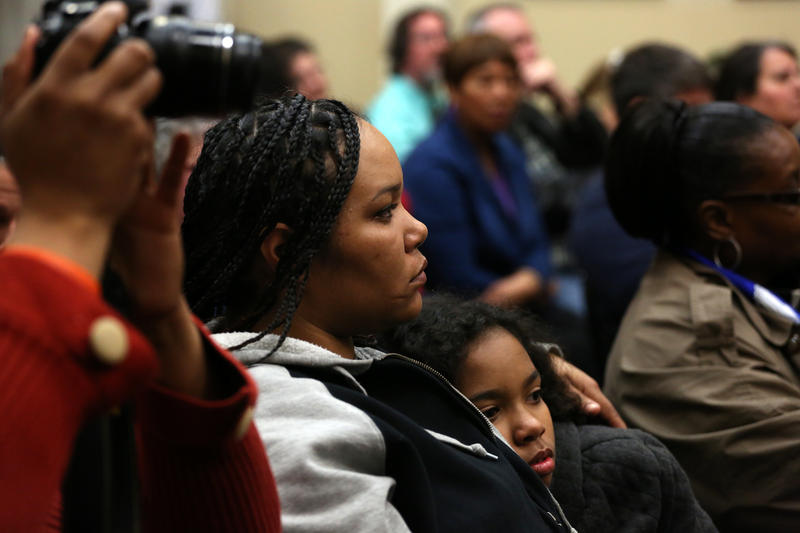 Ferguson residents Francesca Griffin and Mauraye Love, 9,  listen as council members address audience questions Tuesday night, Feb. 2, 2016.
