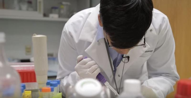A still frame of Avik Som working in a lab, taken from a promotional video shot by Washington University in St. Louis.