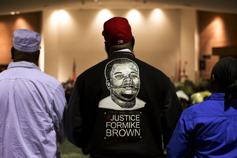 Michael Brown Sr. stands at the back of the Ferguson Community Center's event space during the public comment portion of Tuesday's city council meeting.