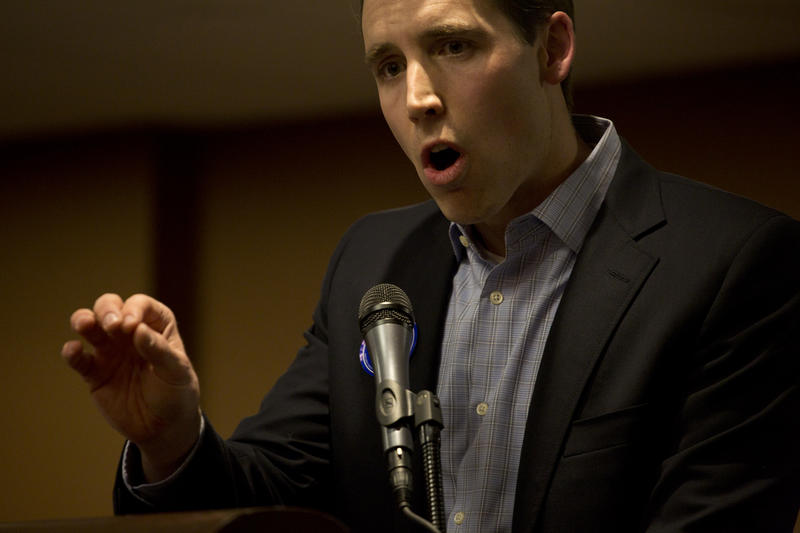 Josh Hawley takes part in a debate.