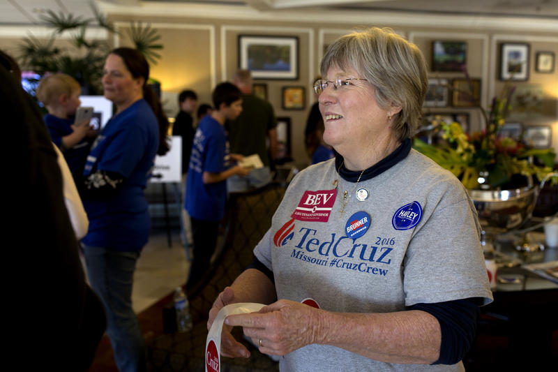 Ted Cruz supporter Geri Thwing spends the afternoon handing out stickers at the Sheraton Westport Plaza entrance during Lincoln Days.