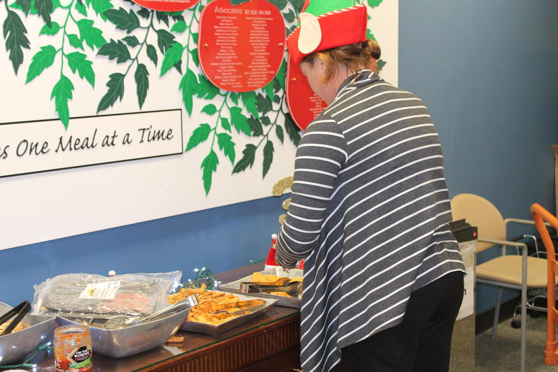 Volunteers at Operation Food Search's December Rap N Pack took a break at the appetizer table.