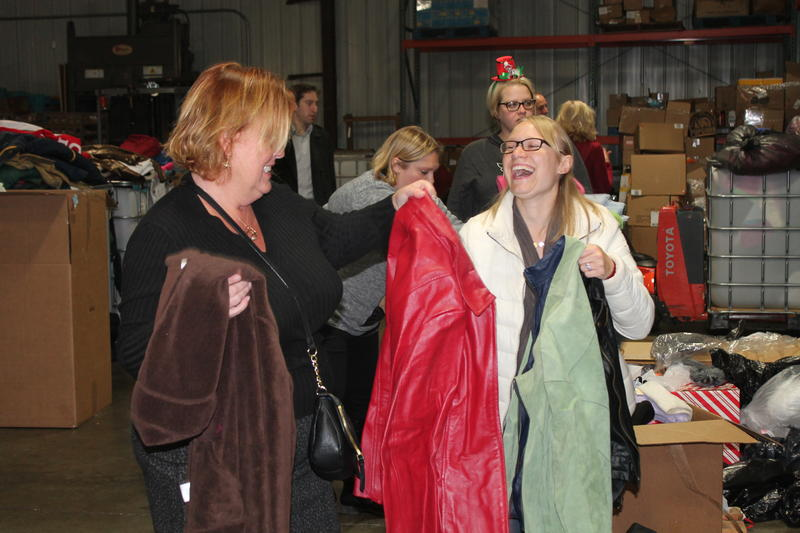 Volunteers had a chance to socialize and network during Operation Food Search's December Rap N Pack.