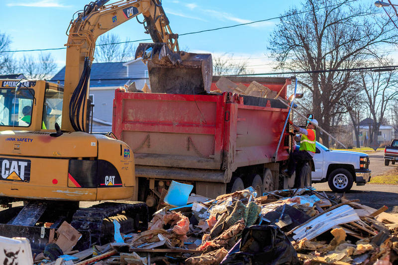 Crews contracted by the Environmental Protection Agency pick up flood debris in Pacific, Mo. in January 2016.
