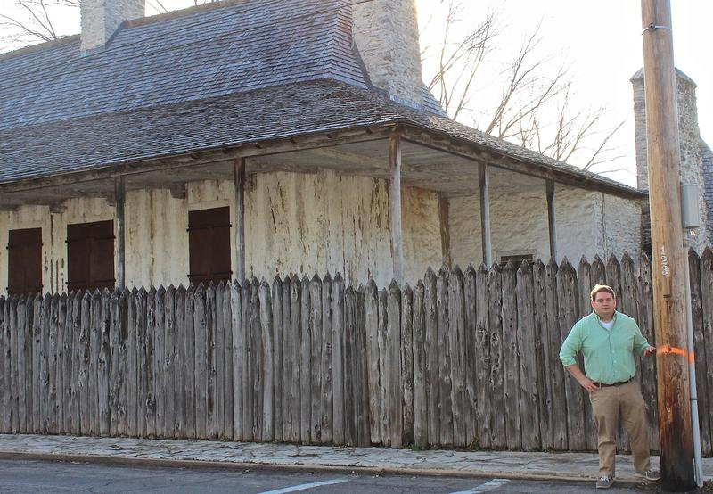 Operations manager Robbie Pratte outside the historic Bolduc House. The orange line on the post indicates the estimated level of floodwater had the Mississippi River topped the levee in Ste. Genevieve in December.