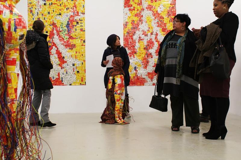 Visitors to The Luminary on Cherokee Street examine Basil Kincaid's work.