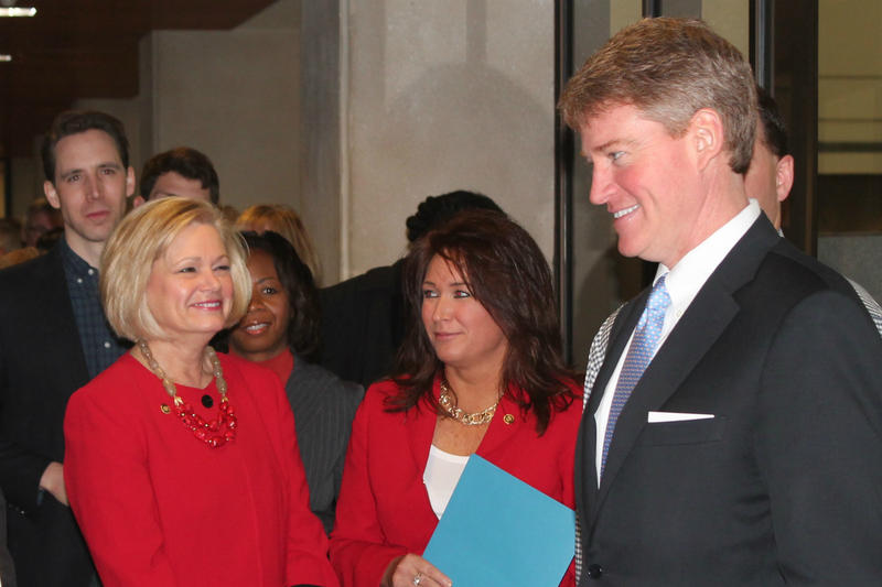 Attorney General Chris Koster, who is seeking the Democratic nomination for governor, talks with others in the line to file.