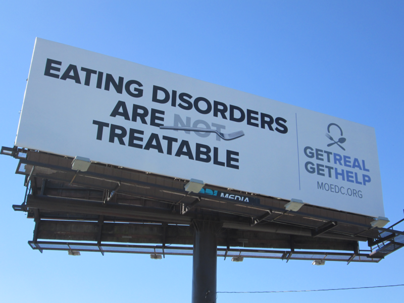A billboard depicting a common myth about eating disorders.