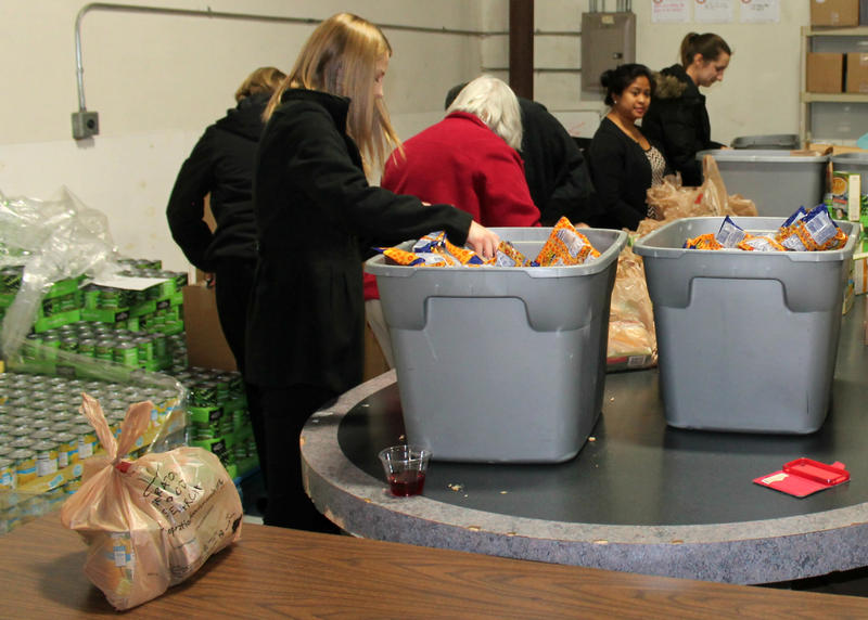 Volunteers got a chance to enjoy drinks and snacks and socialize while volunteering at Operation Food Search's December Rap N Pack event.