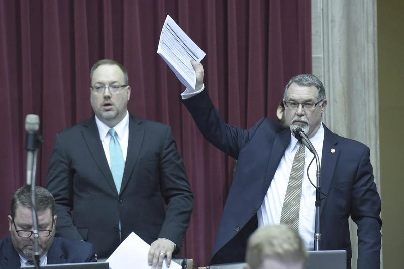 House budget chair Tom Flanigan, R-Carthage, at right, directs debate on budget bills Tuesday.