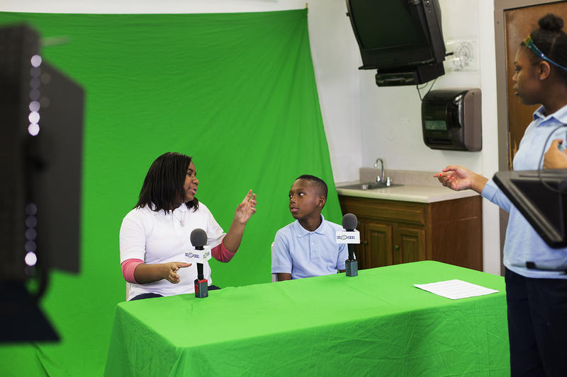 Co-anchors Karen Lomax and Amorion Bland discuss their delivery while recording an episode of Koch TV.