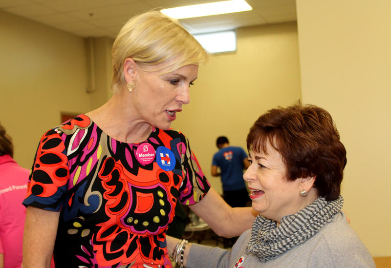 Planned Parenthood President Cecile Richards greets phone-bank volunteer Maxine Clark at Hillary Clinton's St. Louis campaign headquarters Sun. Mar. 13, 2016.
