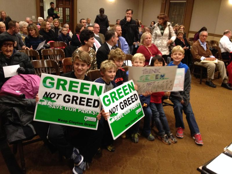 Schoolchildren brought signs to a meeting of the Clayton Board of Aldermen expressing concern that a former school could become high-density housing.