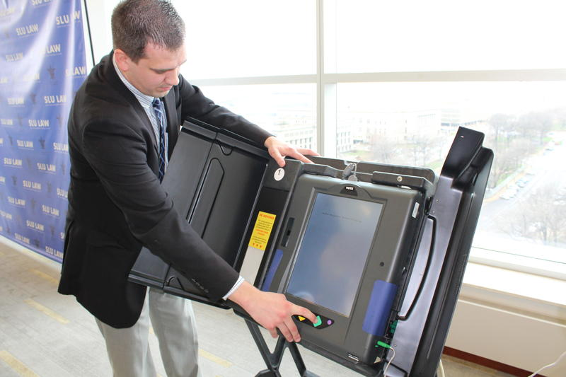 Eric Fey, St. Louis County Board of Elections director, demonstrates how to select an audio ballot versus the large-print option on the iVotronic system.