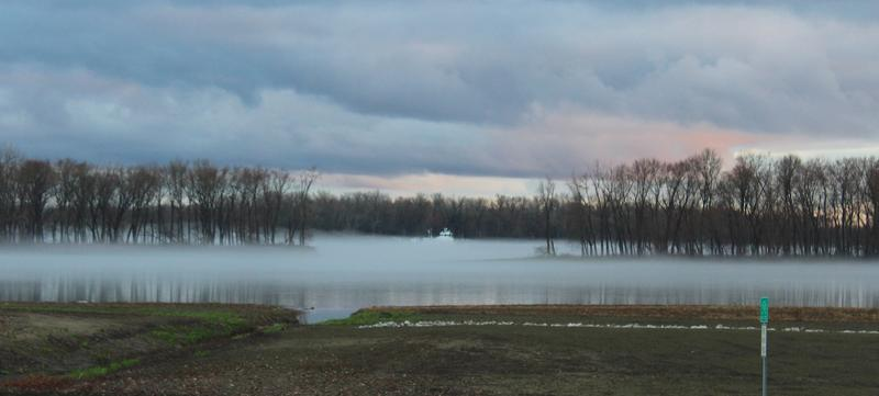 River traffic was halted by the fog, but by evening the barges were moving once more.