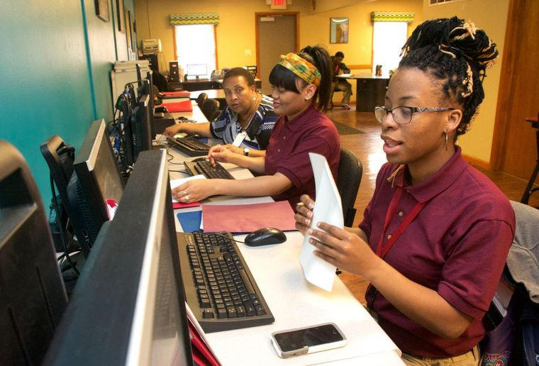 Shameika Wills and Tyler Parker received instruction in office administration from LaTunya Cropper (far left) at the St. Louis Job Corps Center on North Goodfellow Avenue on February 18