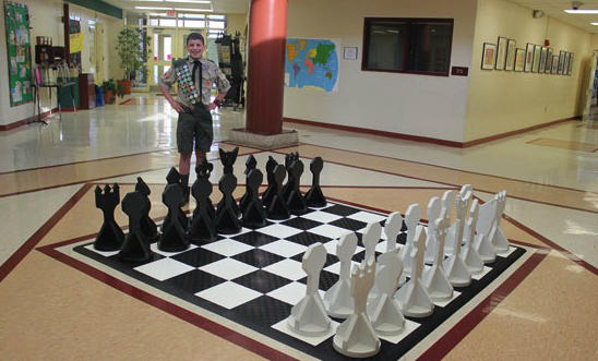 Joshua Becher constructed his own giant chess set, in which each of the pieces are represented by different scouting ranks.