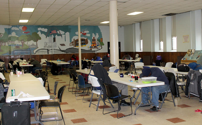 People who are homeless rest in the cafeteria at the Bridge Outreach on Wed. March 30, 2016.