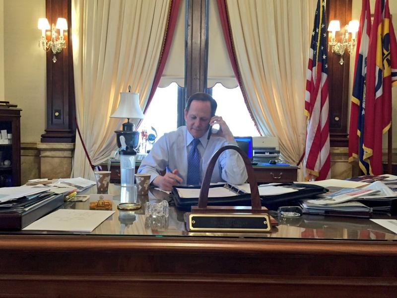 Mayor Francis Slay takes a call from NGA director Robert Cardillo telling him the agency will stay in the city of St. Louis