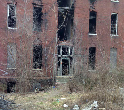 The back door of St. Mary's Infirmary shows some of the deterioration of the building.