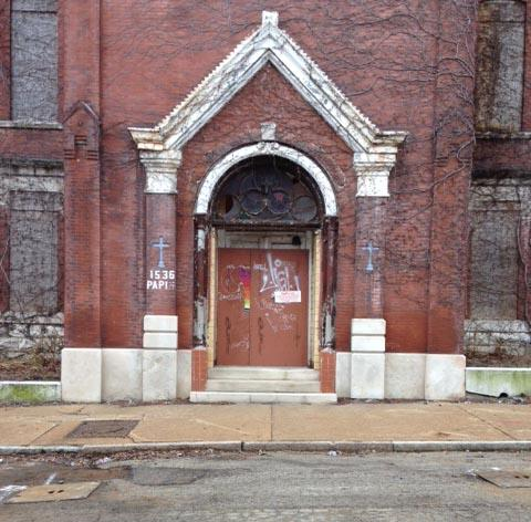 The front door of St. Mary's Infirmary looks as though there would be hope for the building.