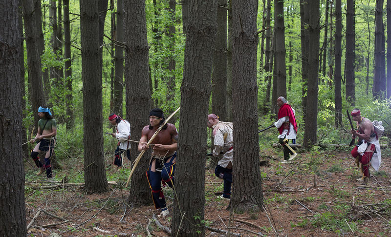 Re-enactors walk quietly through the woods at Busch Memorial Conservation Area in St. Charles County.