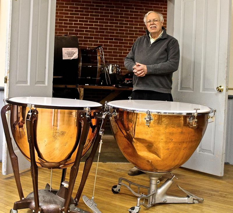 Robert Howard, retiring conductor of the Belleville Philharmonic Society, says the dented timpani, at right, needs to be replaced.