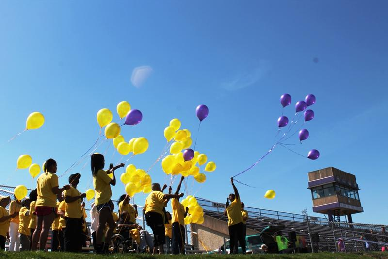 Vanessa Hughes, right, releases purple balloons in honor of her son Justin, who received a heart transplant in 1997.