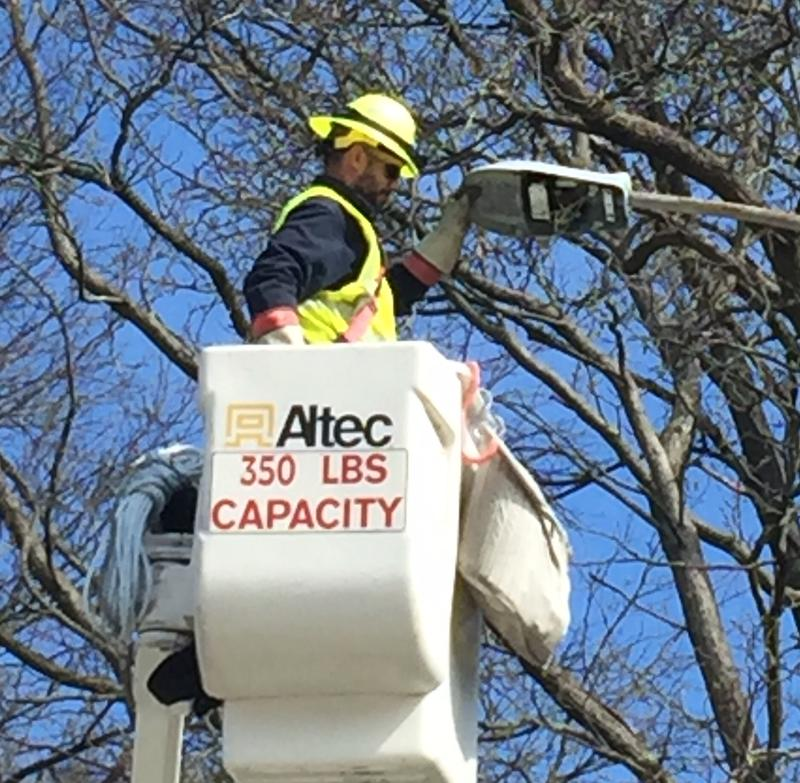 Ameren worker installs LED streetlight