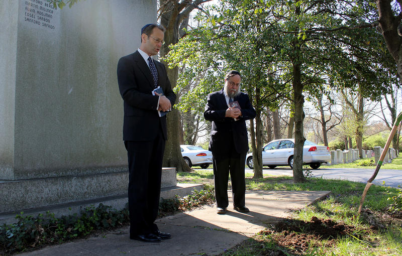 Cantor Howard Shalowitz and Rabbi Yosef Landa lead a burial service for an unknown Holocaust victim on Sunday, April 3, 2016 at Chevra Kadisha Cemetery in St. Louis County.