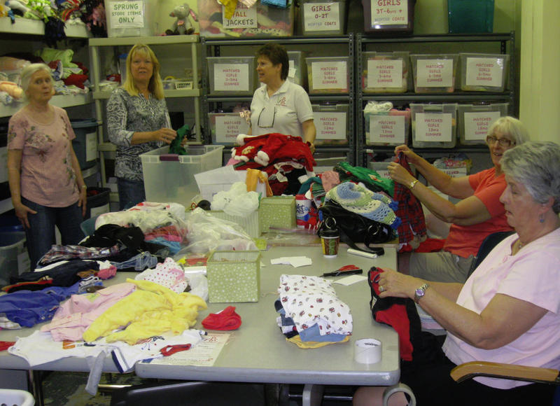 Linda Spina, center, with helpers sorting donations to Nurses for Newborns.