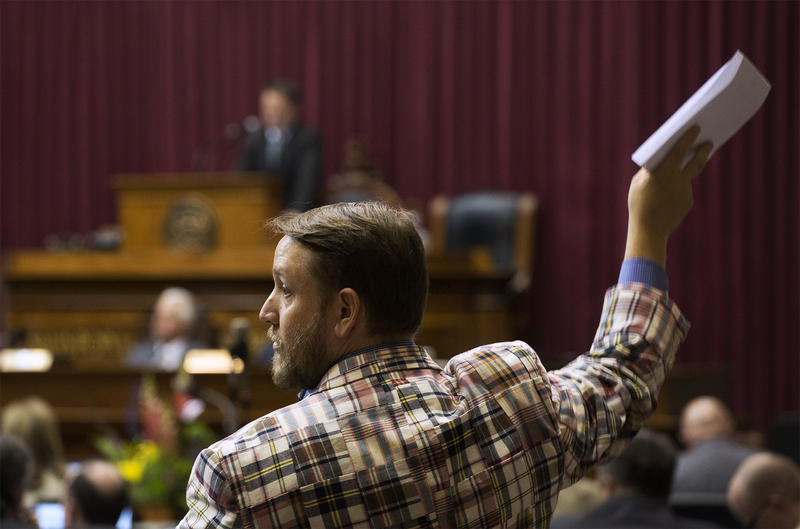 State Rep. Jeremy LaFaver, D-Kansas City, raises his hand to speak before the House of Representatives adjourned.