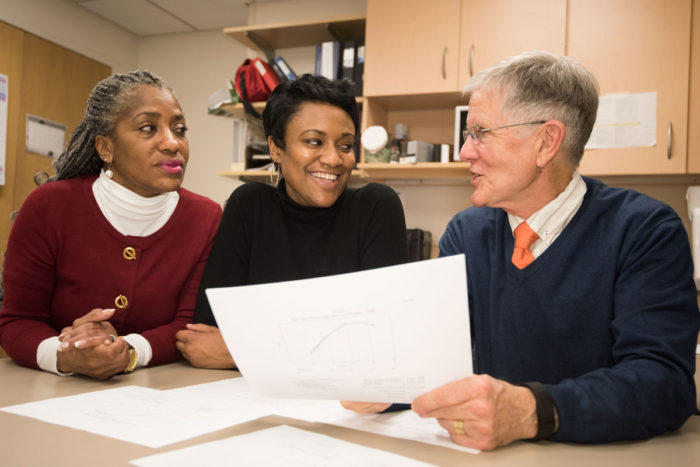 Robert C. Strunk, MD, (right) discusses results of a decades-long pediatric asthma study that involved Janae Smith, (middle) a patient and study participant, and Denise Rodgers, (left) who retired this year as a clinical research coordinator.