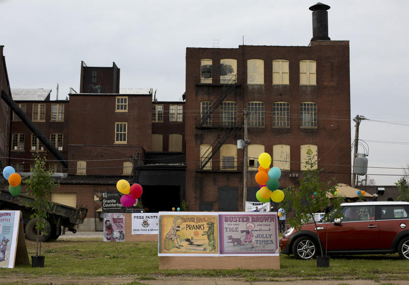 Signs set up outside the old Buster Brown factory invited passers-by to Jim Osher's party.
