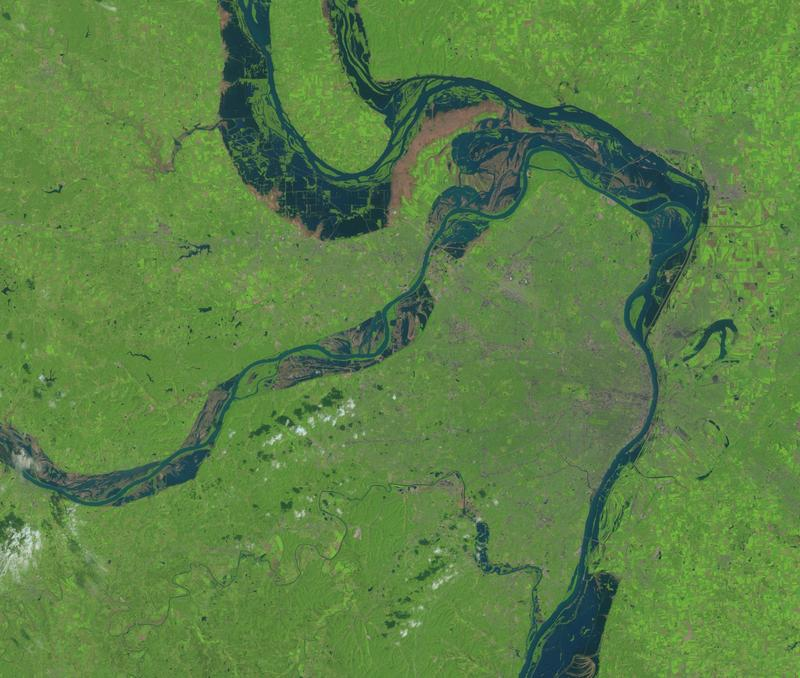 USGSA satellite image of the St. Louis region, taken on Aug. 19, 1993, shows the confluence of the flooding Mississippi and Missouri rivers, with the combined rivers narrowed at St. Louis (greyish area at center-right in photo) by levees and the flood wal