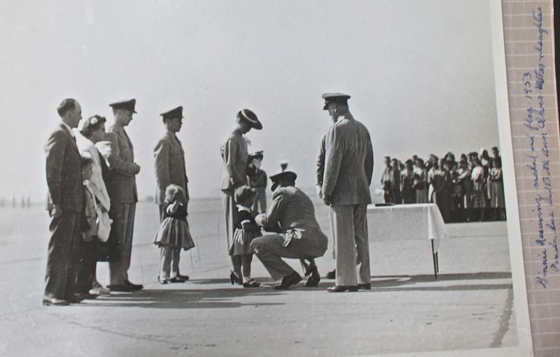 In this picture from Beth Vincent's collection, she is awarded one of her father's medals  in 1953 after he was declared Killed in Action. Her mother holds the American flag presented during the ceremony. Her older sister appears to be saluting.