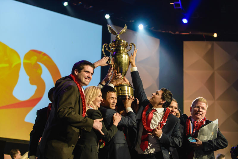BYU-Hawaii Enactus students hold their 2015 championship trophy.