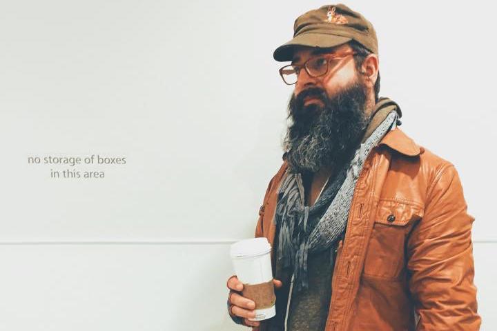 Beardy Eric Hall stand with coffee cup