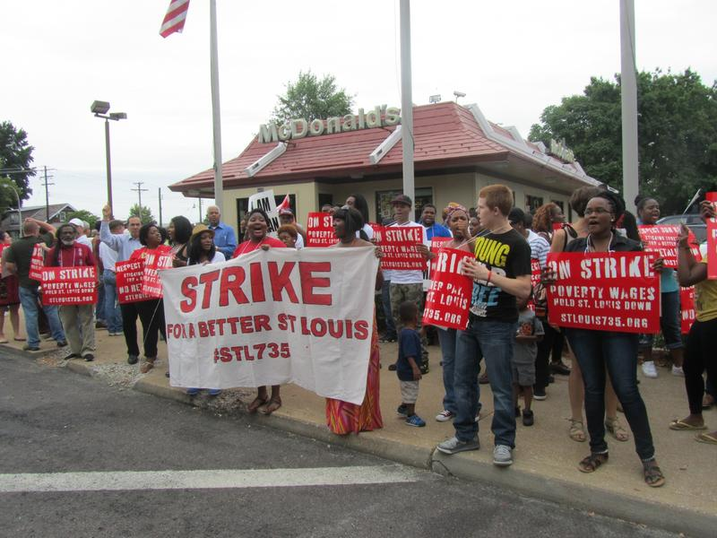 Fast-food workers demonstrate for higher wages as part of a national effort.
