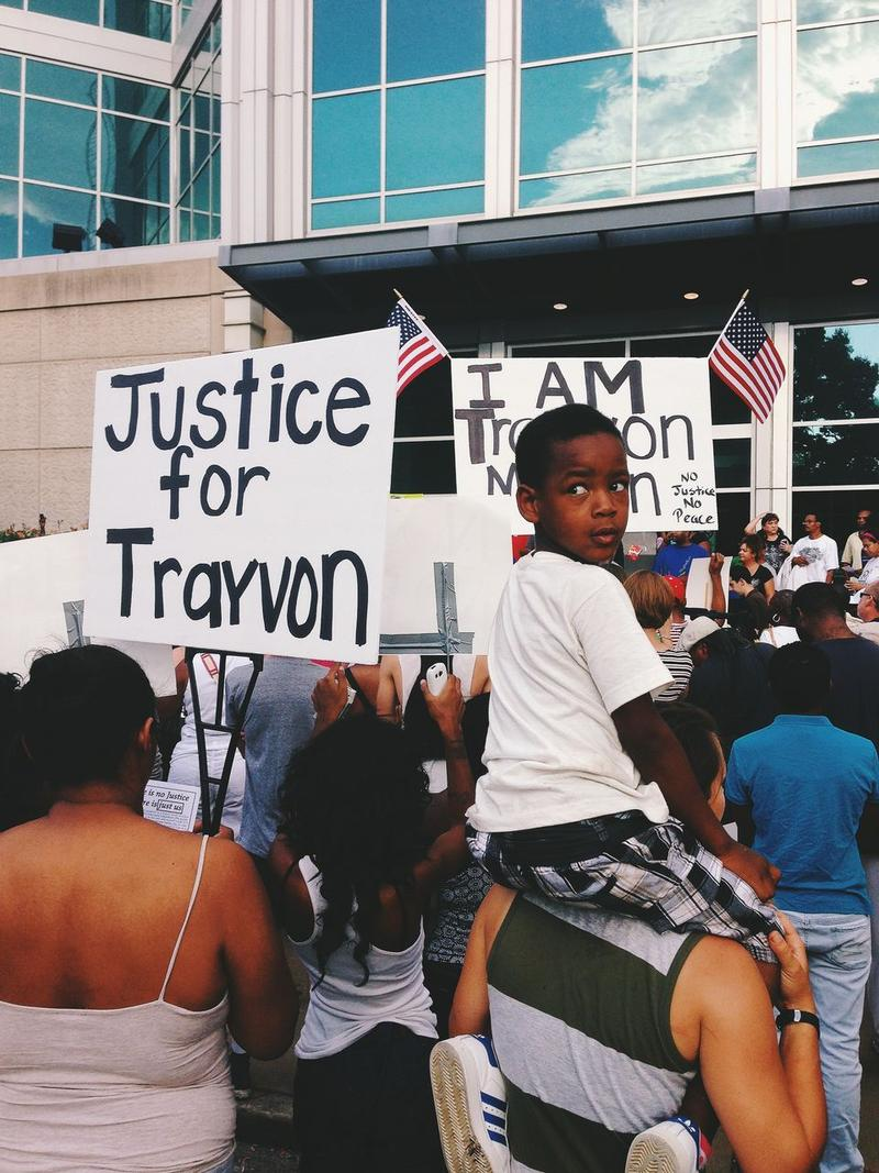 Rally to protest George Zimmerman's acquittal was held Sunday night in front of St. Louis' Justice Center.