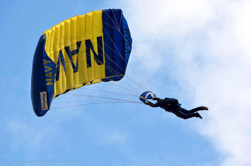 A sailor in the sky with a Navy parachute