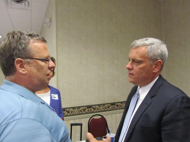 Roy Temple, right, was unanimously elected Saturday as the chairman of the Missouri Democratic Party. He's speaking with St. Charles County Democratic Party chairman Morton Todd.