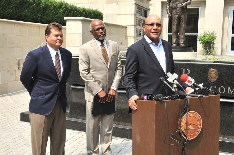 County Executive Charlie A. Dooley, center, announced two nominations to the county police board: Dave Spence, left, and Freddy J. Clark.