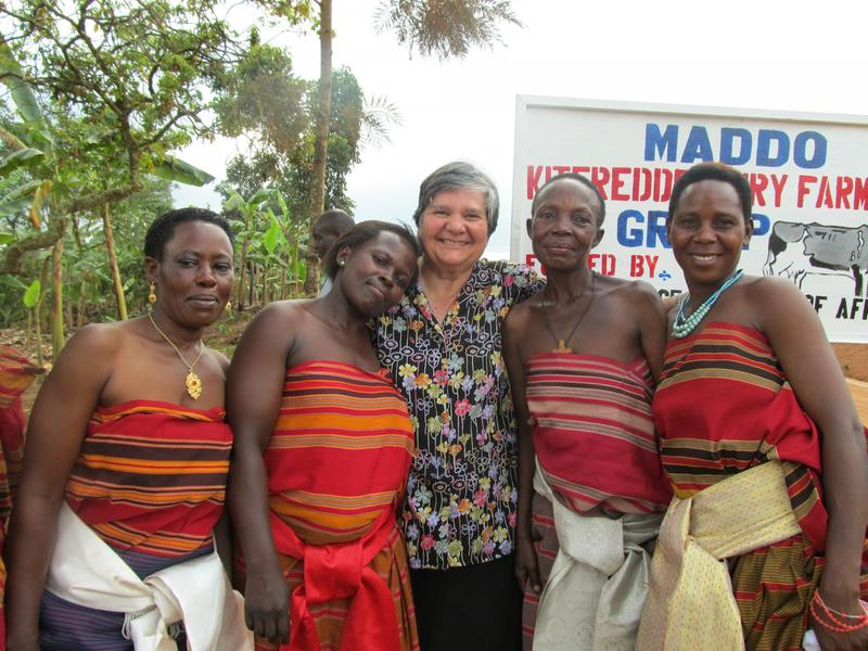 Sister Toni Temporiti (center) with women of the village of Kiteredde in Masaka, Uganda. They were celebrating the completion of their farm preparations and the fact that they would soon receive their cows.