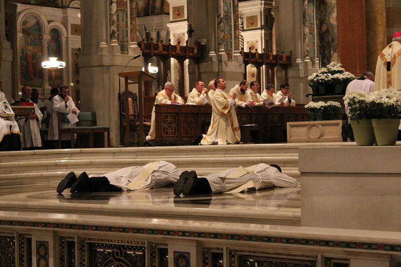 Rev. Kent Pollman and Rev. Scott Scheiderer supplicate themselves during their rite of ordination on Saturday, May 28, 2016 at the Cathedral Basilica of St. Louis.