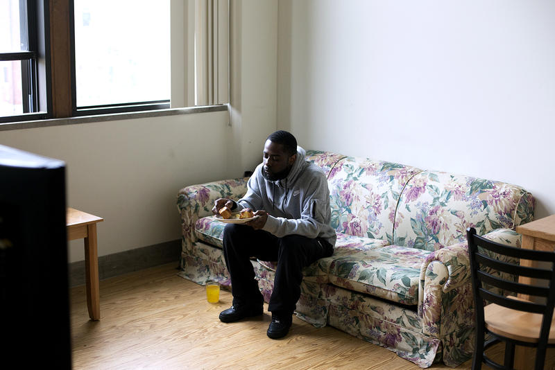 Quinton Reed eats a home cooked lunch and watches TV at his Garfield Commons Apartment. Reed was diagnosed with schizophrenia after years of struggling with homelessness.